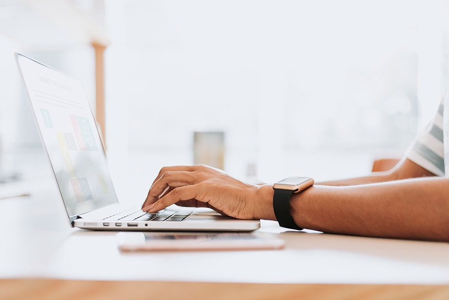 person typing on a laptop, Video Marketing Grants